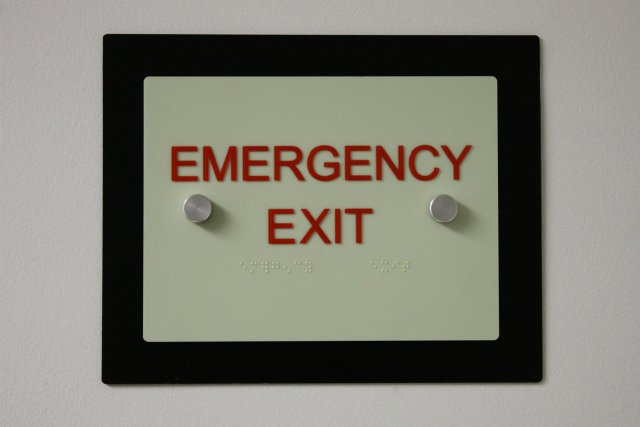 Glow in the dark accessibility door signs.