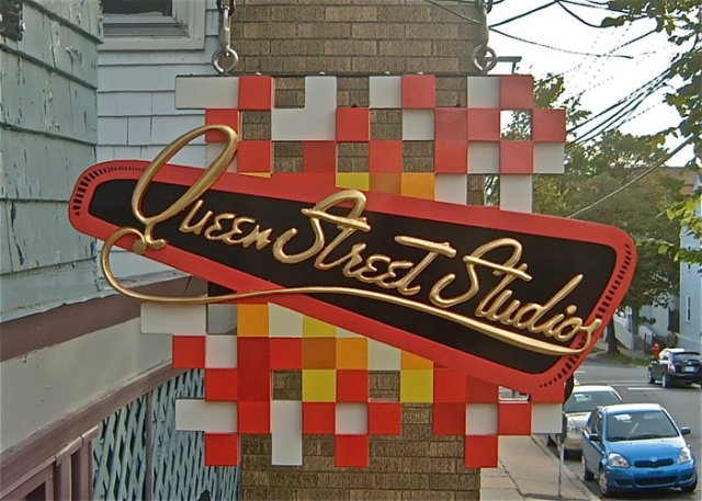 Queen Street Studios Multiple planes of CNC-cut PVC backer panel finished with custom mixed paint. Raised gilded text. 2' x 3'