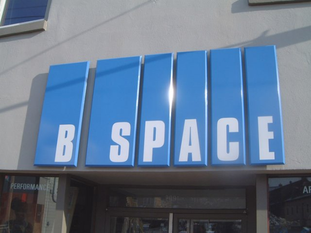 B-Space Painted extira panels with beveled edge and applied vinyl text.