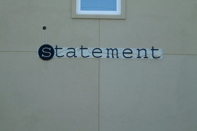 Statement 1/4' Lexan with 3/4' painted PVC text. Approximately 8' x 1'