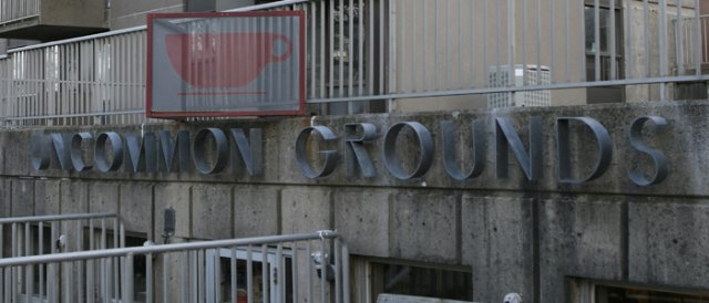 """Uncommon Grounds Perforated stainless steel in a custom frame with painted logo. Each panel is approximately 24"""" x 36"""""""