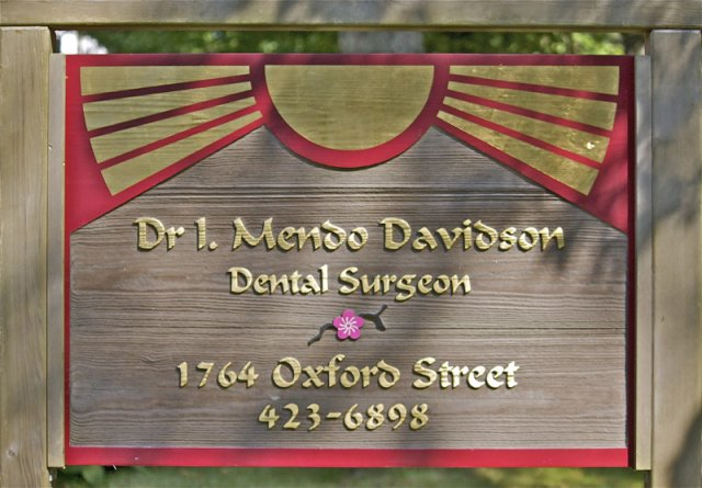 Dr. Mendo Davidson Sandblasted clear red western cedar. Treated with natural oils to encourage natural graying of aged cedar. The deep tones of the wood are contrasted by gold gilded text and border. Post constructed using traditional joinery methods.