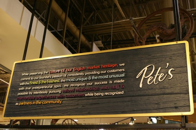 "Pete's Mission statement 6' x 30"" Clear western cedar sandblast. Gold metalic paint sets off against black background. Designed by blu solutions."