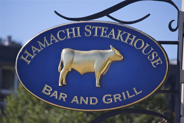 Hamachi Steak House HDU backer panel with sculptural element. Air brushed with custom mixed paints and gilded with 23k gold. Custom bracket built to nest sign.