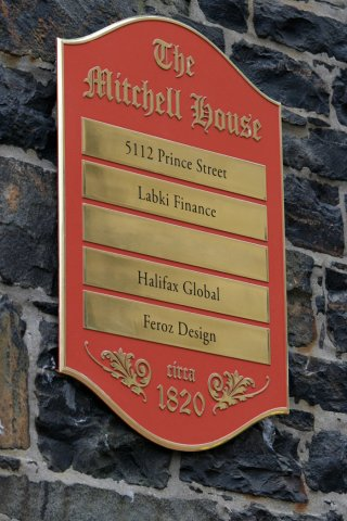 Mitchell House Plaque Polished brass plaque painted custom colours. Polished name plates with applied vinyl. Installed with blind pin-mounts.
